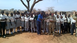 Handing over pencils and writing pads at the Community school Archer's Post